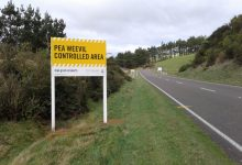 Signs alerting those entering Wairarapa to the pea weevil threat. Photo/supplied