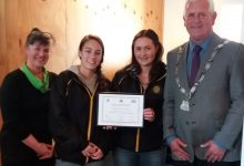 Carterton Mayor John Booth with members of the Dalefield Hockey womens team. PHOTO/SUPPLIED