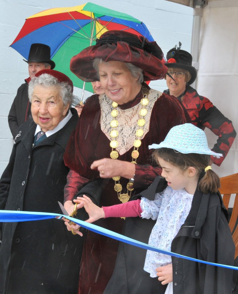 Kitty Muir, Mayor Lyn Patterson and April Wyeth of Opaki School cut the ribbon. PHOTO/CHRIS KILFORD