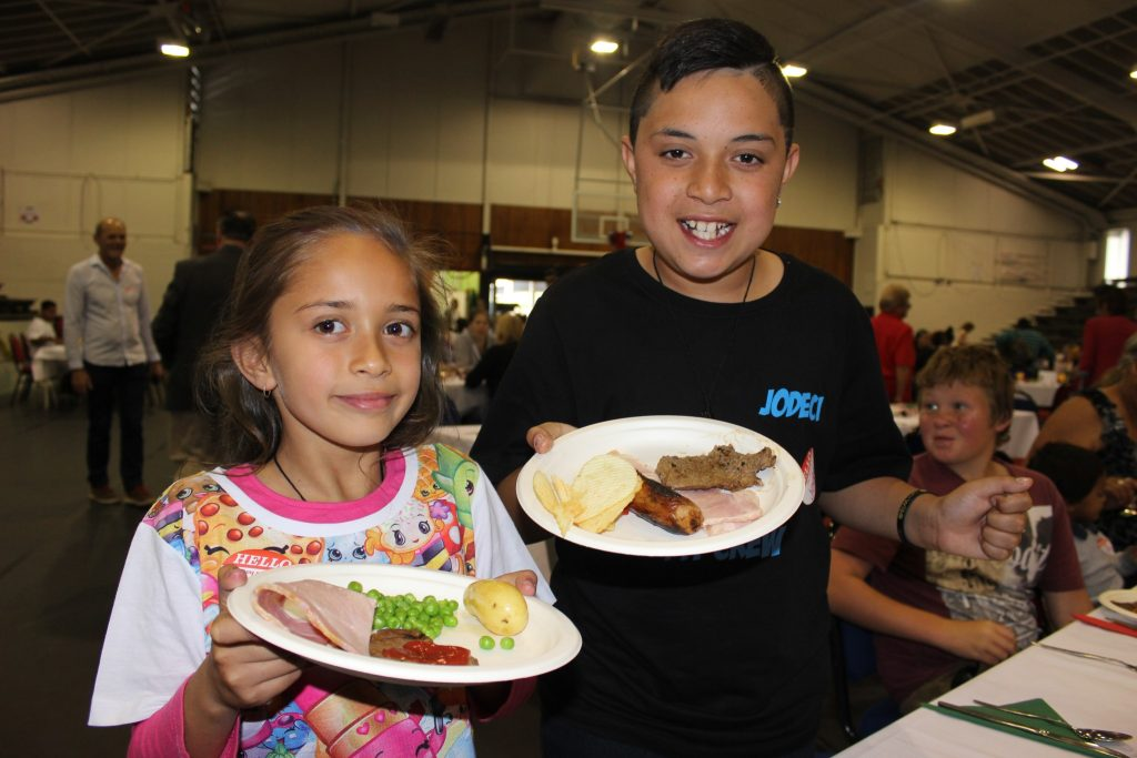Alexia Apiata, 7 and her brother Jodeci, 10 get ready to dig in to their Christmas feed. PHOTO/EMILY NORMAN