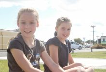Phoebe Wylie, 10 and Lily Allan, 10, big-hearted youngsters from Opaki School who are raising money for the Wairarapa Cancer Society. PHOTO/CHELSEA BOYLE.