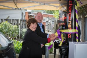 South Wairarapa Mayor Viv Napier mans the new electric charging station with Colin Olds, who was a catalyst for seeing it come to the town. PHOTO/FILE