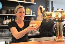 Owner Kylie Mole pulls a pint at her new restaurant and bar in Carterton. PHOTO/CHELSEA BOYLE