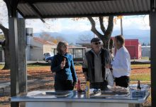 Jane Davis, Allan Renall and Brian McWilliams enjoy the new barbecue in Carrington Park. PHOTO/CHELSEA BOYLE