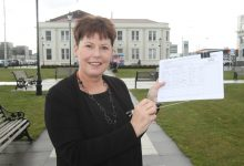 Masterton District Councillor Bex Johnson with a petition to bring in a poll for amalgamation. PHOTO/EMILY NORMAN