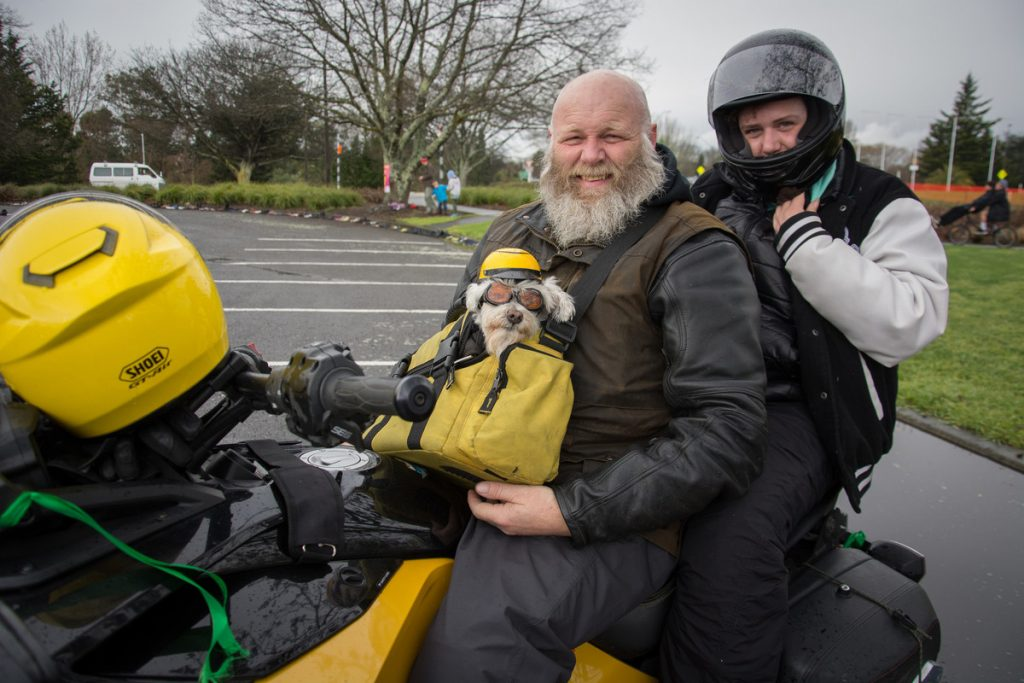 Craig Mclean from Rotorua with his dog, Ziggy Spider Rider, and Jess Smaling from Wainuiomata. PHOTO/JADE CVETKOV