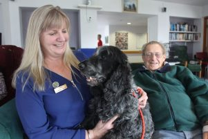 Diversional therapist Faye Leveridge, her dog Dougal, and Carter Court resident Bill Cardno. PHOTO/EMILY NORMAN