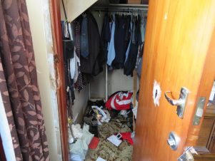 The wardrobe with its broken lock, and gun safe in the back left corner. PHOTO/JAKE BELESKI