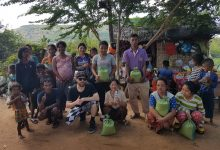 Drew Johnstone with the villagers in Cambodia.