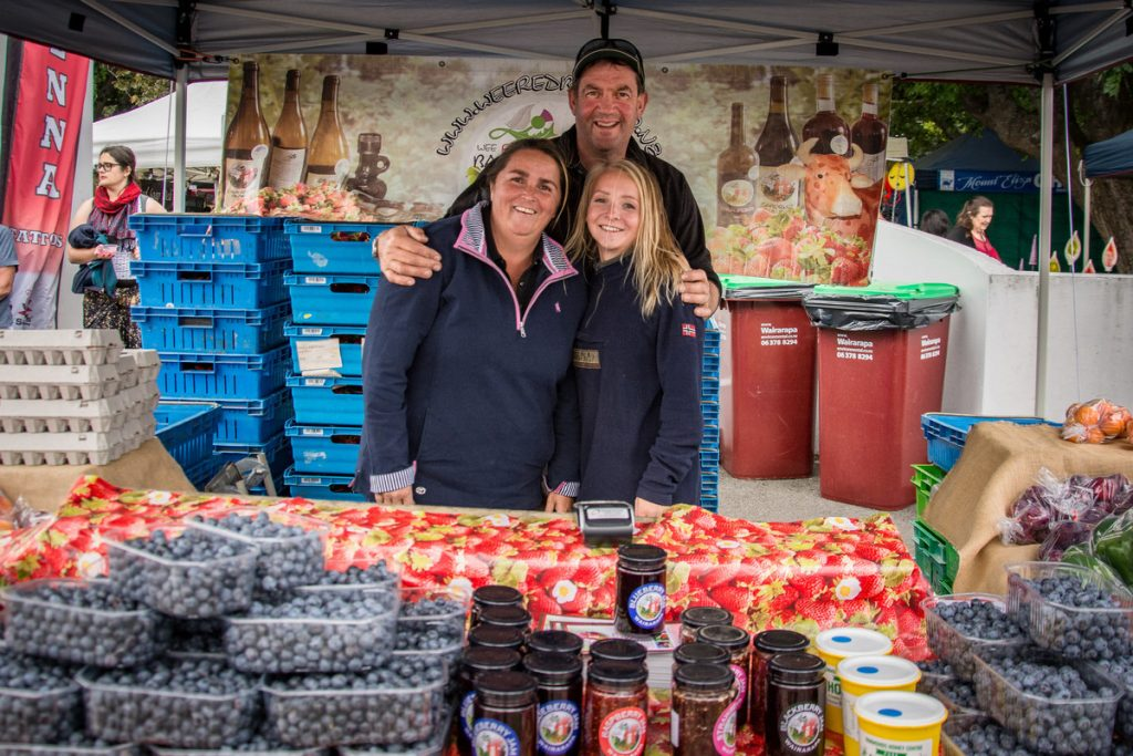 Allan, Dot and Emily, from the Wee Red Barn, selling their fresh berries. PHOTO/JADE CVETKOV