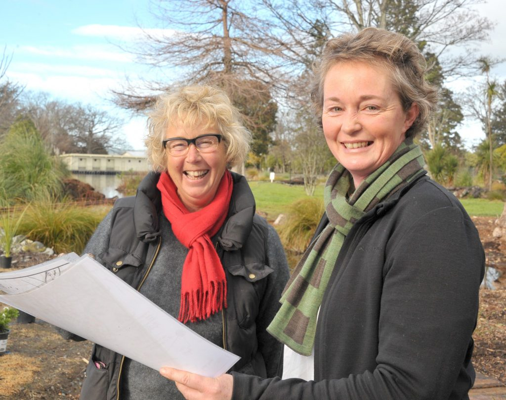 Marilyn Hunt and project designer Rachel Callaghan go over the plans.