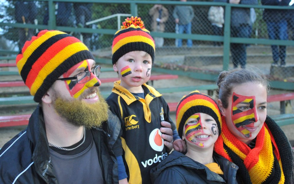 The Perkins family show their support for Greytown: Nick (left), Lachlan, 2, Thomas, 4, mum Danielle.