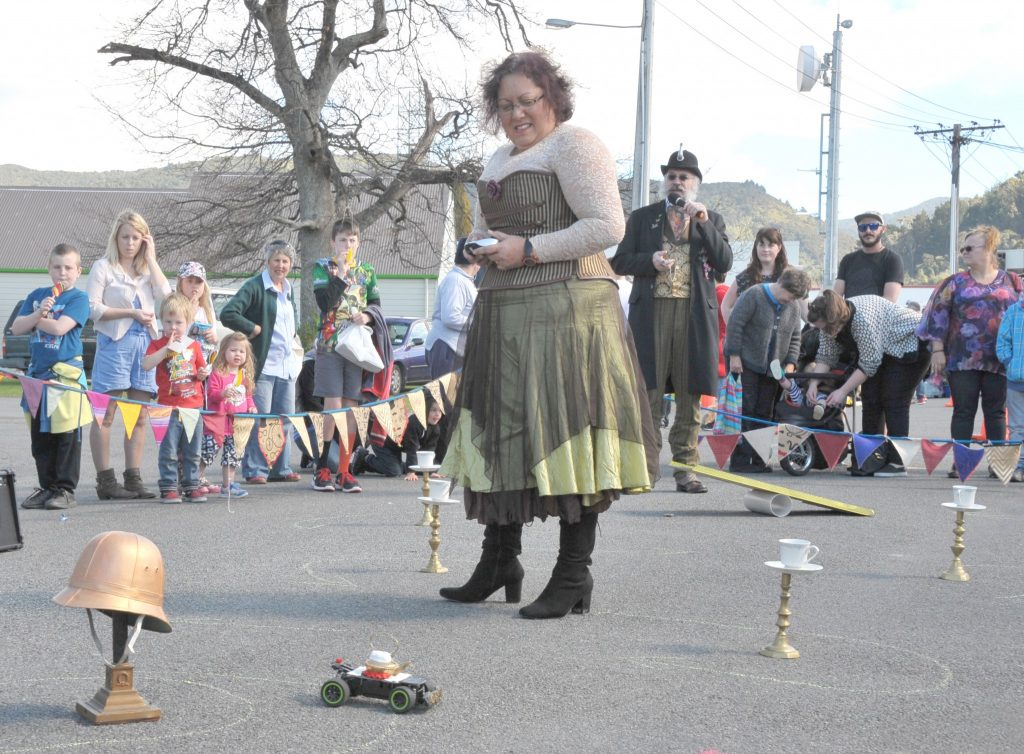 Steampunk's Gaylene van Wijk negotiates her remote controlled teapot around the obstacle course while MC 'Colonel Hawthorne' (aka Leslie Craven) keeps the crowd informed. PHOTO/CHRIS KILFORD