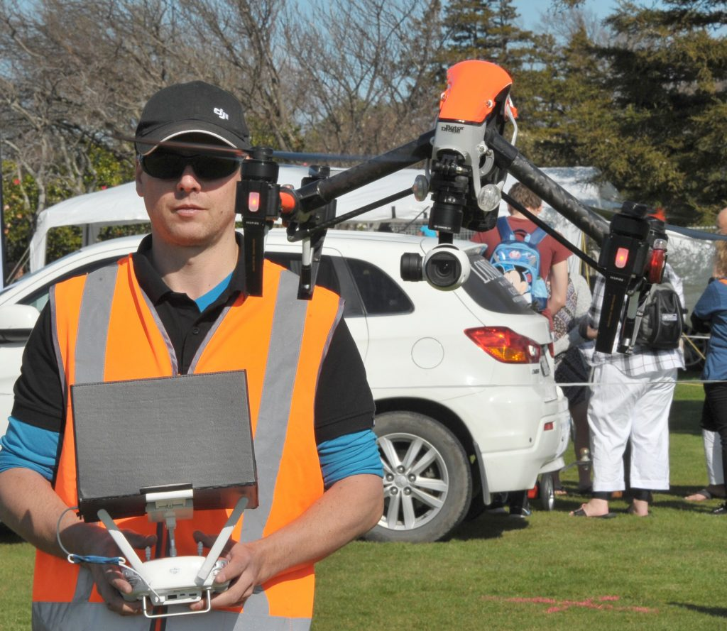 Carterton's Rene Clough of Wairarapa Drone Pilots Group demonstrates one of the flying machines. PHOTO/CHRIS KILFORD