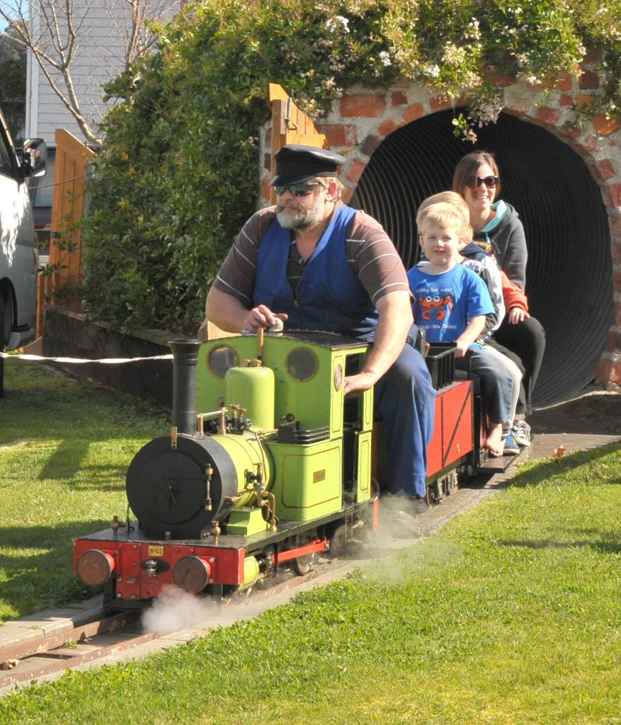 Mini Fell Train driver Peter Gibbs emerges from the tunnel at Featherston's carnival on Saturday. PHOTO/CHRIS KILFORD