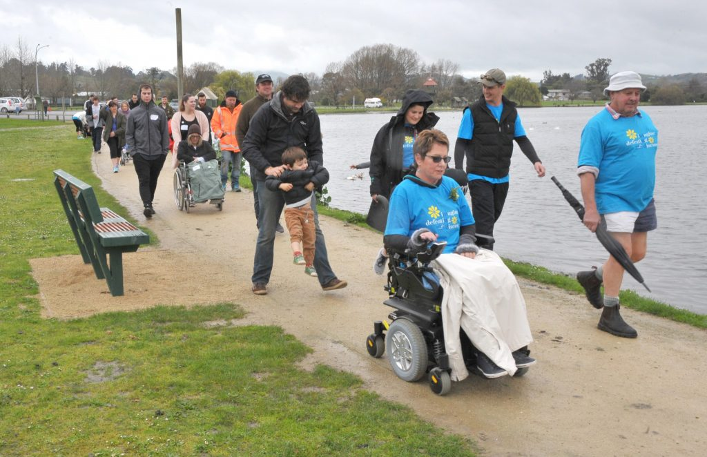 Liz Anderson leads the MND NZ Walk at Henley Lake on Sunday. PHOTO/CHRIS KILFORD