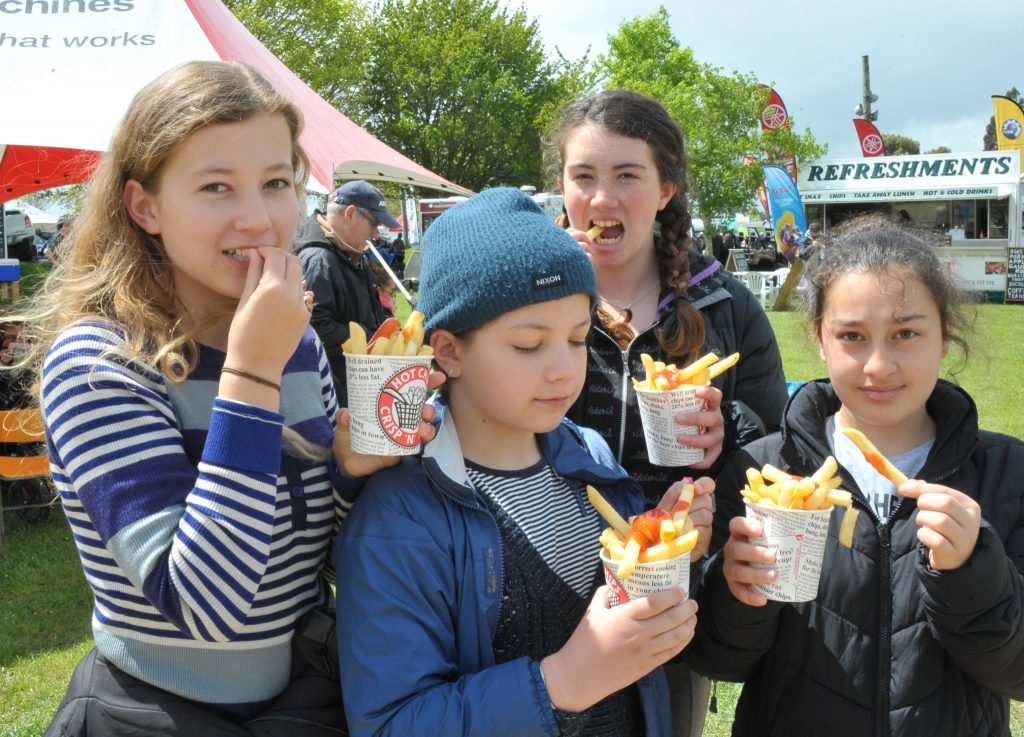 Sadie Galloway, Esther Galloway, Kyla Greenfield and Ronza Lazar, all of Wellington, tuck in to their snacks. PHOTO/CHRIS KILFORD