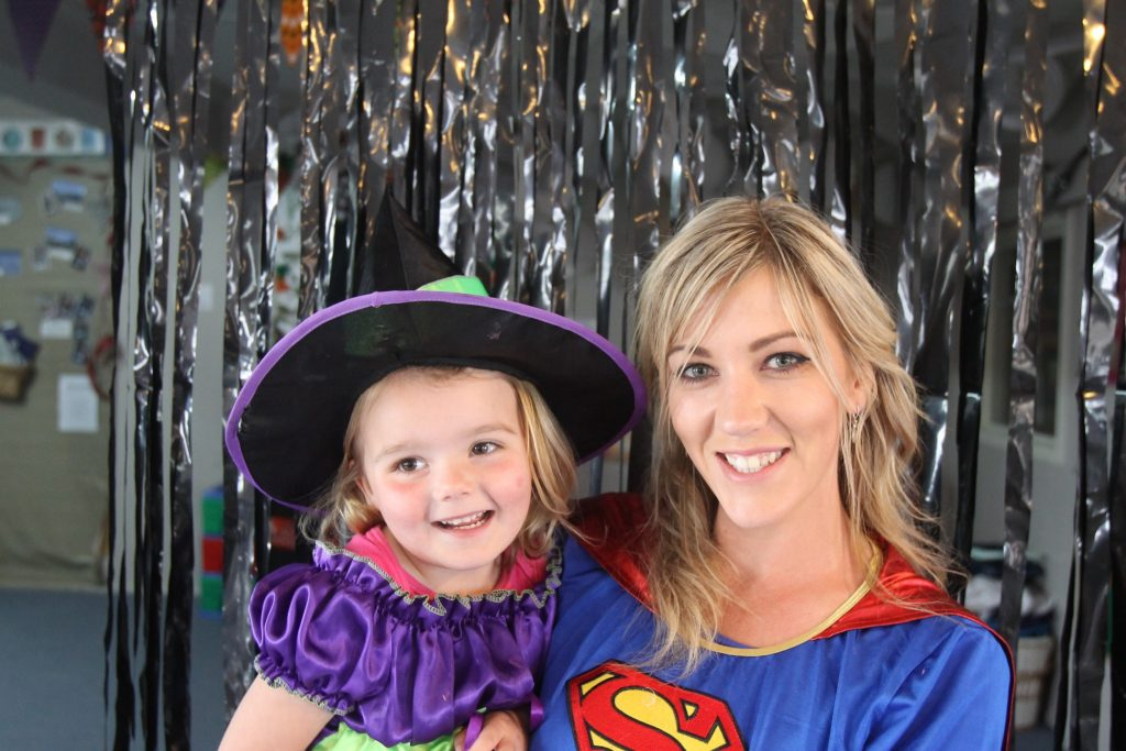 Neveah Brown, 4, with Renee Smith, teacher, celebrate Halloween. PHOTO/BECKIE WILSON
