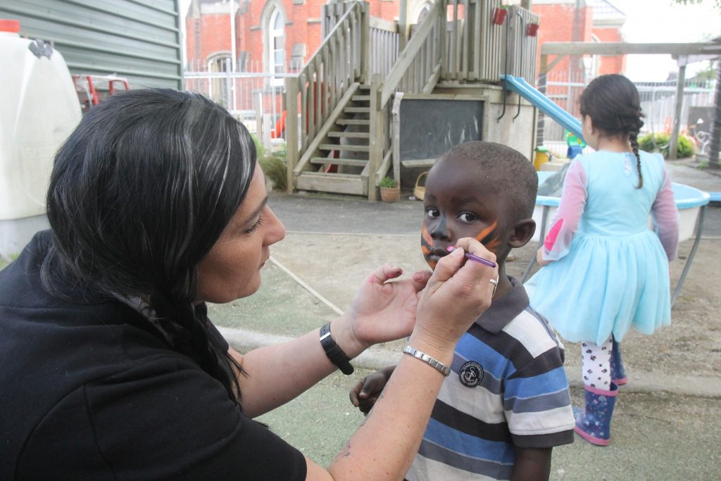 Nathanael Madembo, 3, gets his face painted in Halloween style. PHOTO/BECKIE WILSON