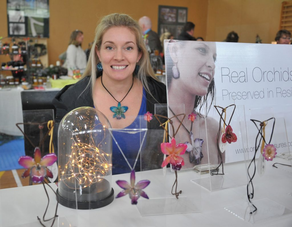Brianna Billing (Kapiti Coast) with her orchids preserved in resin. PHOTO/CHRIS KILFORD
