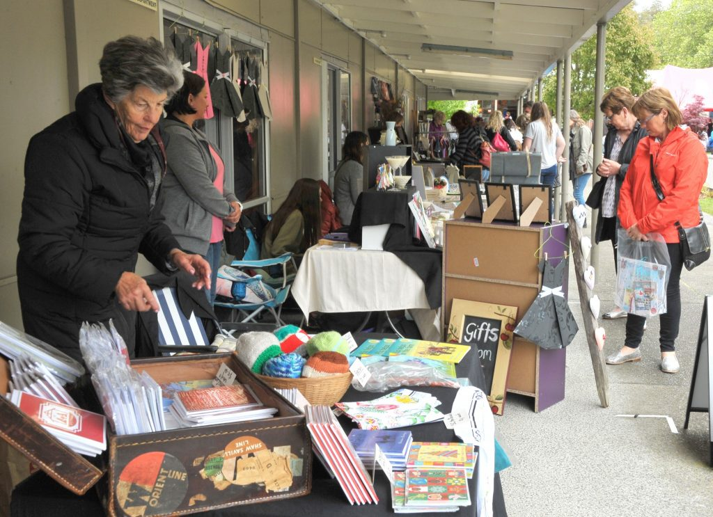 Stallholders set up under the verandahs to get out of the heavy drizzle. PHOTO/CHRIS KILFORD