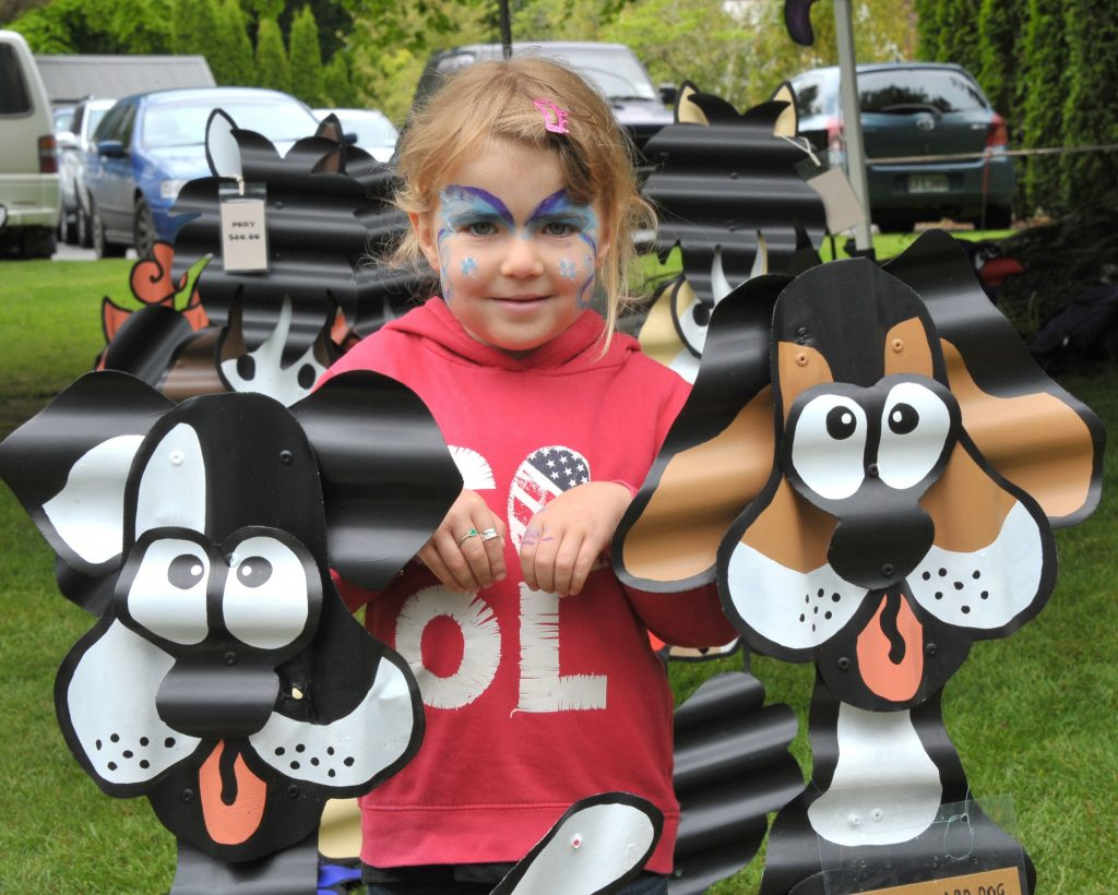 5 yr old Sophie Porten (Carterton) gets protection from the corrugated guard dogs. PHOTO/CHRIS KILFORD