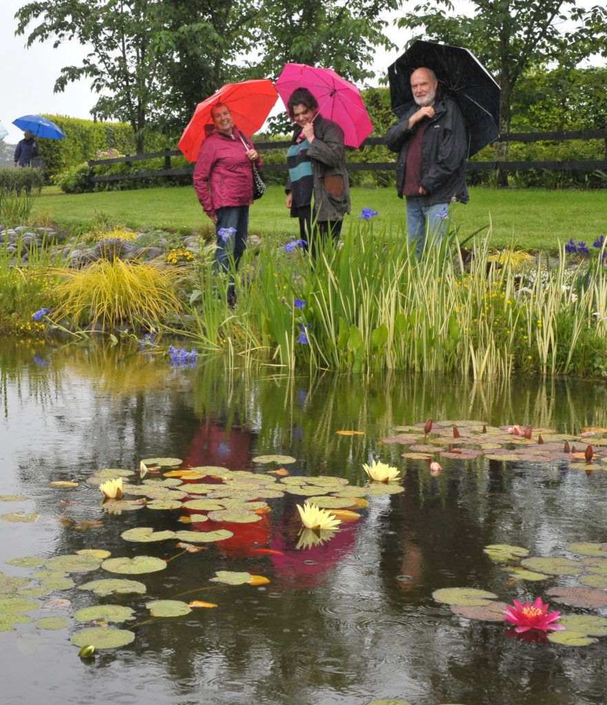 Wairarapa Garden Tour, Greytown, Saturday, Doug, Joan and Shannon Gibbs (Carterton) brave the elements at Highfield Garden. PHOTO/CHRIS KILFORD