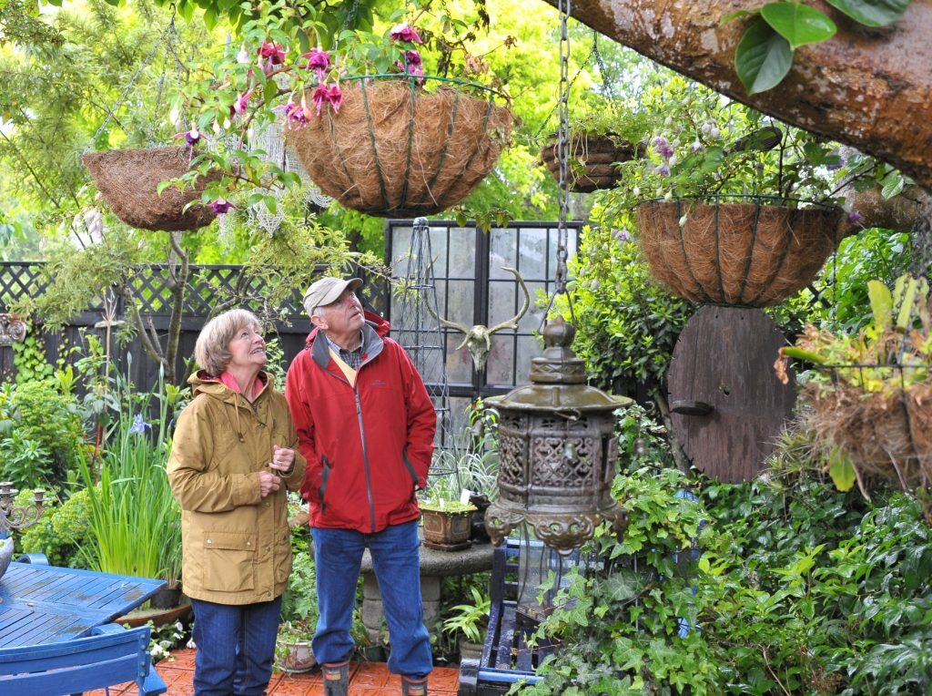Wairarapa Garden Tour, Greytown, Saturday, Marilyn and John Errington (Martinborough) admire the hanging baskets. PHOTO/CHRIS KILFORD