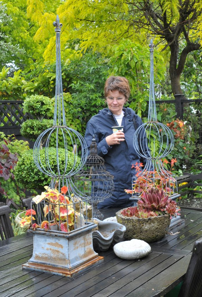 Wairarapa Garden Tour, Greytown, Saturday, Jacquie Brookman (Featherston) admires the table display. PHOTO/CHRIS KILFORD