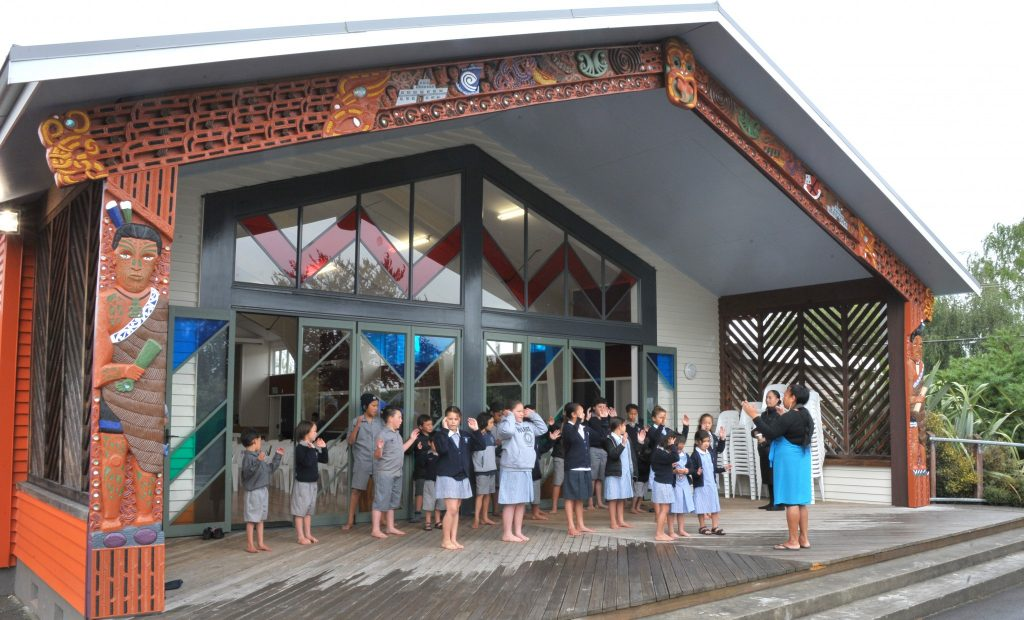 Waiata practice at the front of the whare under the guidance of Lily Arahanga. PHOTO/CHRIS KILFORD