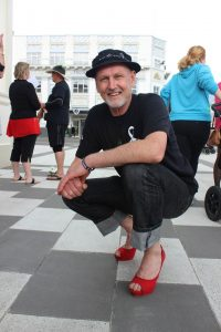 Manager of Stopping Violence Services Wairarapa Jeremy Logan wearing fabulous red heels. PHOTO/EMILY NORMAN
