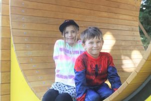 Lani and Jonah Maxwell enjoying the new mouse house on Boxing Day. PHOTO/CHELSEA BOYLE