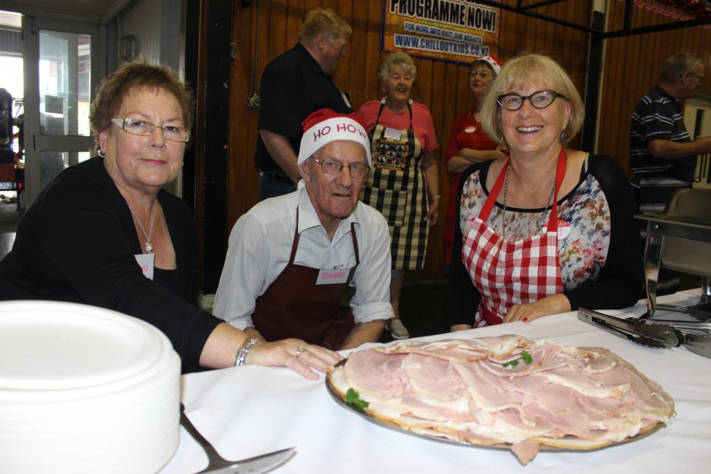 From left, Barbara Lambert and Barry Scobie from Masterton, and Gail MacKenzie of Featherston help dish out the food. PHOTO/EMILY NORMAN