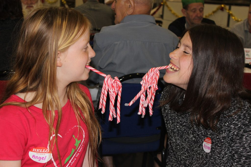 Sisters Angel and Michaela Norman show off their candy cane haul. PHOTO/EMILY NORMAN
