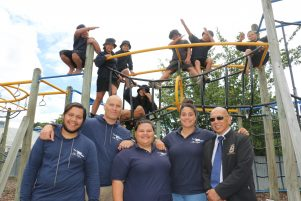 The Ka Rewa crew, (from left) Whatahoro Fox, Nathan Riwai-Couch (aka Chopper), Kendyl Walker, AJ Aporo and kaumatua Ben Fox, with some of the Featherston School kids who will be doing the course. PHOTO/HAYLEY GASTMEIER