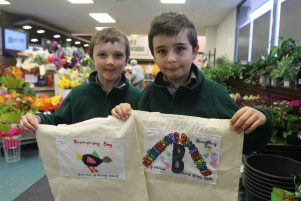 St Patrick's pupils Connor Kube, 8, left, and Lucas Stoneley, 9 show off the boomerang bags. PHOTO/EMILY NORMAN