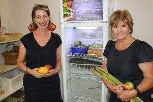 Roz Walker, left, and Pam Shackleton at the community larder, based at Martinborough Health Centre on Oxford St. PHOTO/HAYLEY GASTMEIER