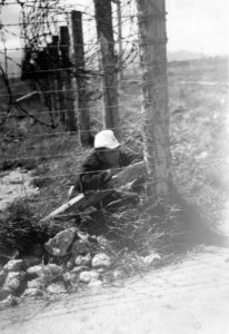 A Japanese POW sitting by a barbed wire fence at Featherston POW camp, taken in 1945. PHOTO/WAIRARAPA ARCHIVE