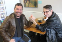 Paul Greville of the Masterton District Library, and Barry Stroud wearing his prosthetic finger. PHOTO/EMILY IRELAND
