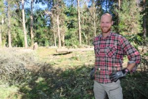 Tomas De Gooijer, from the Netherlands, clearing trees to make way for a new vegetable garden at the eco farm in Tauherenikau.