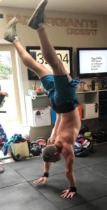 Martinborough's CrossFit trainer Matt Guild handstand walking. PHOTO/SUPPLIED