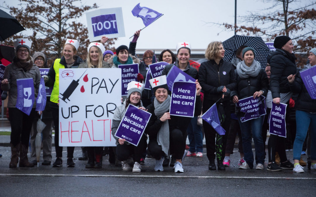 'Here because we care' – nurses on strike