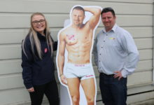The cardboard cut-out promoting Brent Gare, right, a finalist in the Woman's Day's HOttest Radio Hunk contest, with his nominator, Mediaworks promotions coordinator Saphron Yaxley. PHOTO/HAYLEY GASTMEIER
