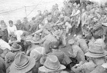 Two groups of men taking part in a piggyback tug-of-war troopship headed for Europe in WWI. PHOTO/WAIRARAPA ARCHIVE