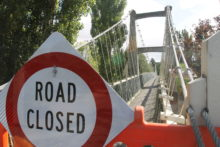 Troubled bridge over toxic water