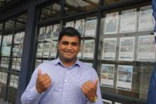 Teen climbing ladder in real estate career