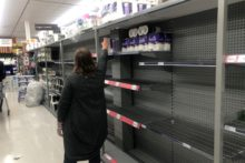 Panic buying as virus bites