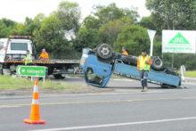 Truck flips at crash hotspot